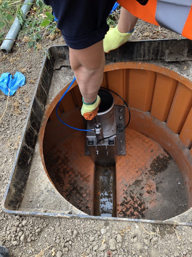 Sewer Flow Regulator During Installtion into a Plastic Chamber on a New Housing Estate